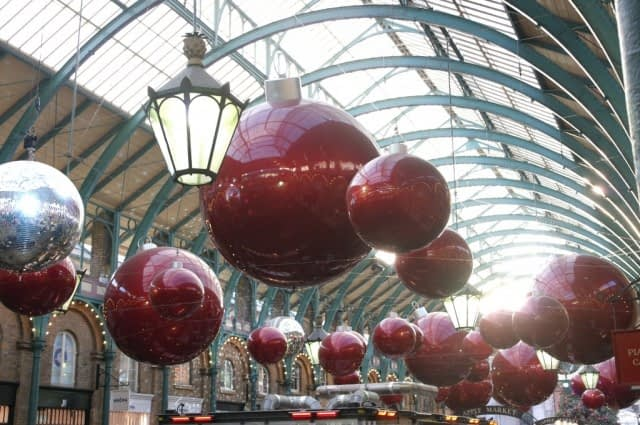 Giant bauble decorations in Covent Garden Market building